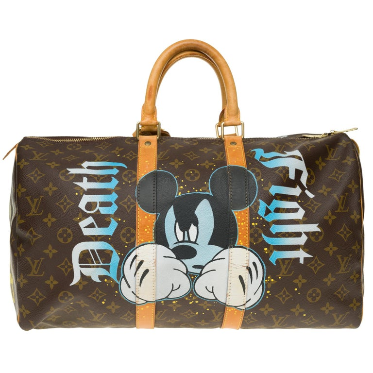 Superb travel bag Louis Vuitton Keepall 45 cm in Monogram canvas customized by the trendy artist of Street Art Patbo on the theme