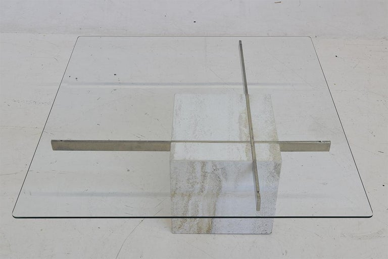 This wonderful asymmetric travertine table was designed in 1975 by Artedi in Italy. Timeless Italian design.