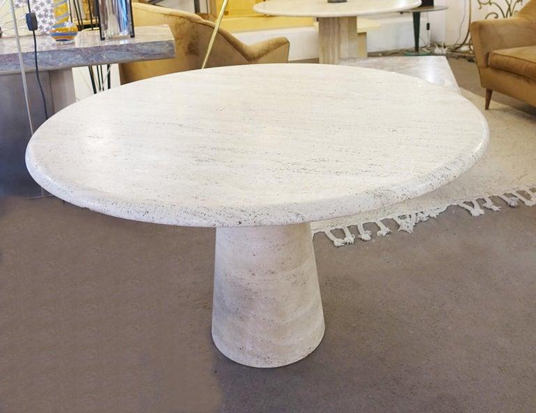 Travertine circular dining table in the style mangiarotti.