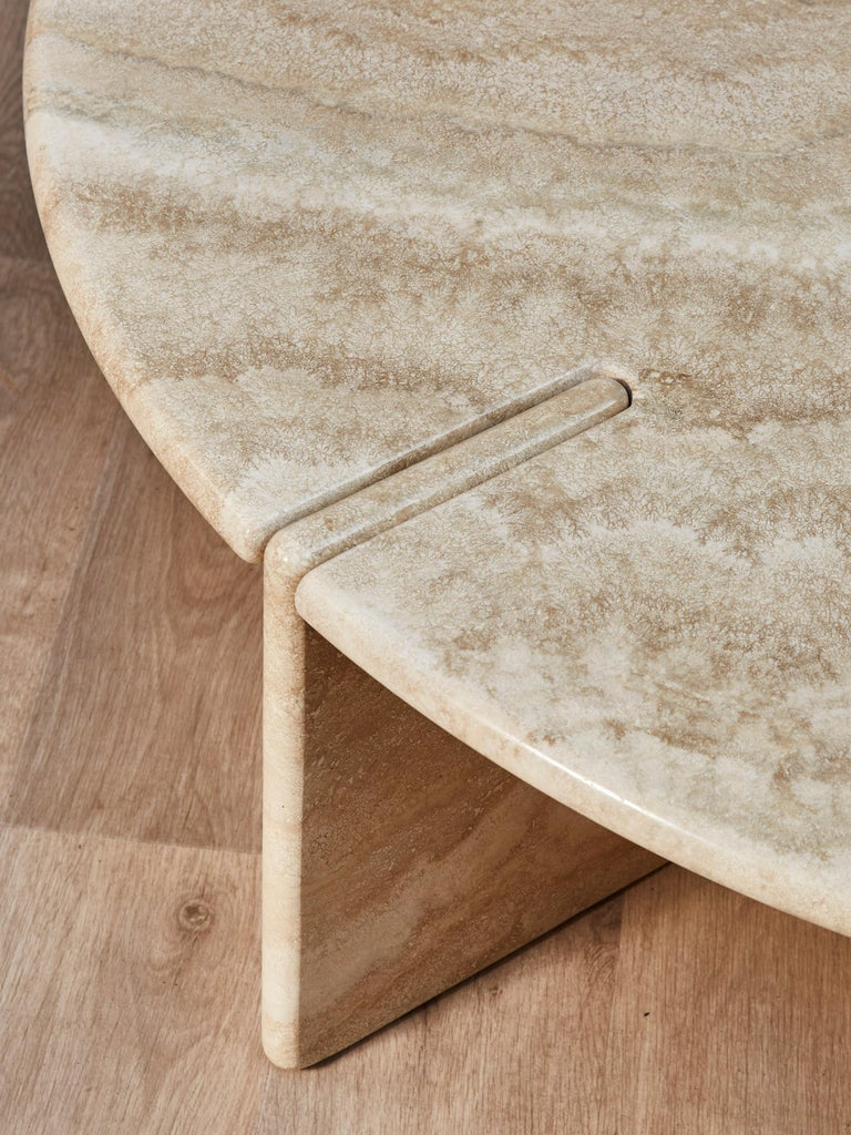 Elegant cocktail table entirely made of massive travertine stone. Piece realized by Studio Glustin, France, 2021.