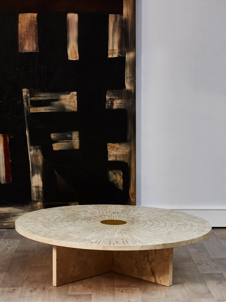 Unique coffee table in travertine stone worked in marquetry and brass.  Creation by Studio Glustin. France, 2021.