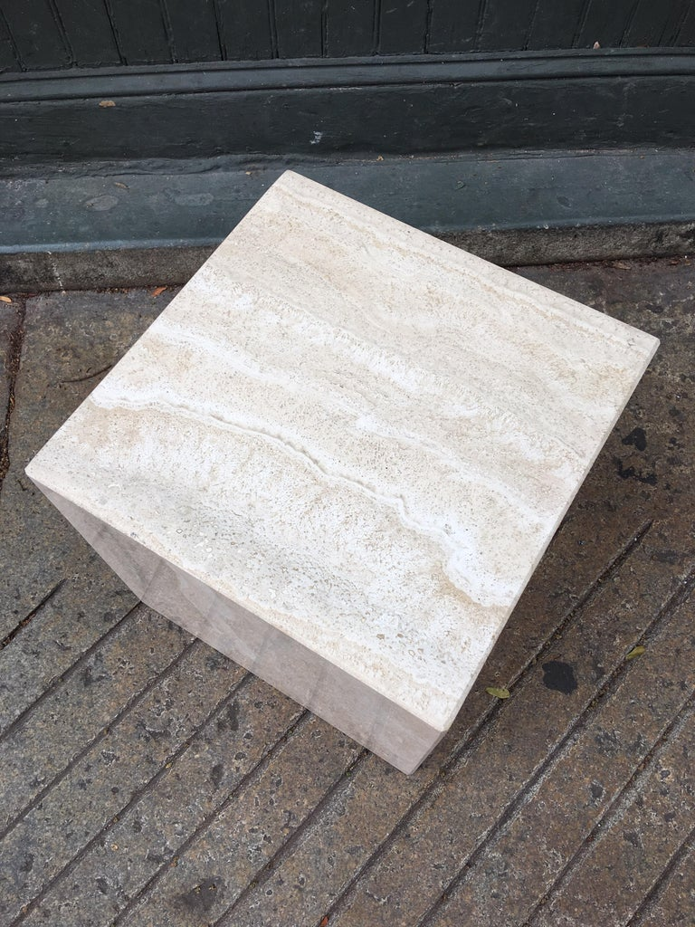 Nice square travertine cube, great to use as a side table or low stool.