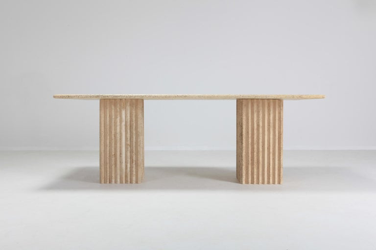 Postmodern table, travertine marble, attributed to Carlo Scarpa, Italy, 1970s  can be used as a writing desk or dining table.  The two impressive columns are not attached to the table, these can be placed freely underneath the top. You could