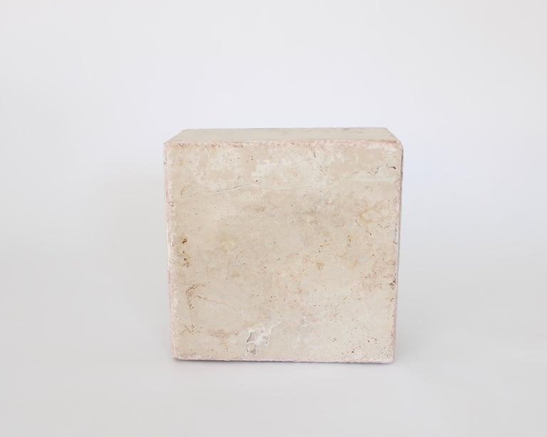 Italian travertine rectangular tall side tables, end tables, coffee table or a great drinks table. Each table is composed on different travertine slabs making each table unique. Each slab is chosen for its unique veining and texture. These tables