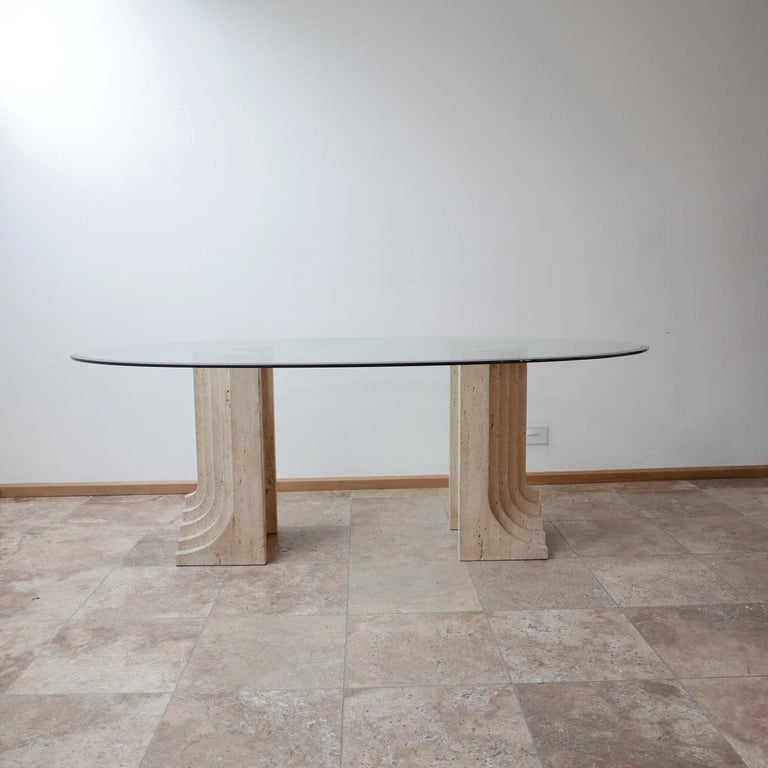 A solid travertine dual base dining table attributed to Carlo Scarpa.