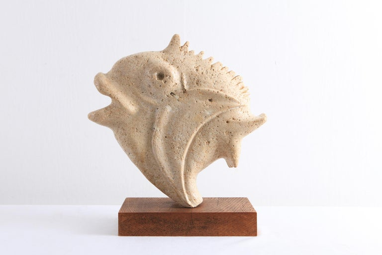 Mid-Century Modern sculpture in travertine, mounted on a wooden base.