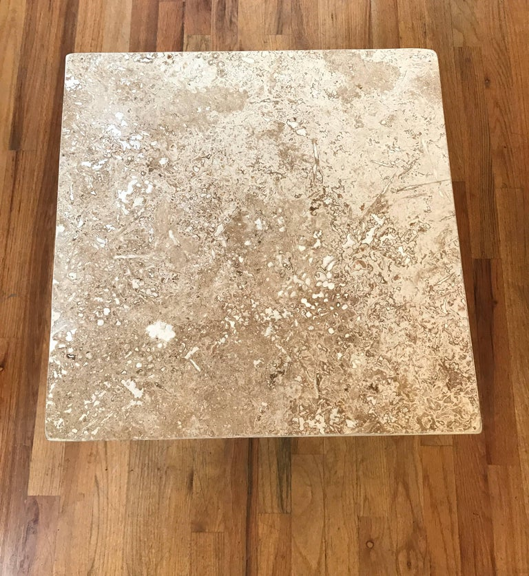 Travertine side or end table. This modern richly veined cube would make for a good drinks table.