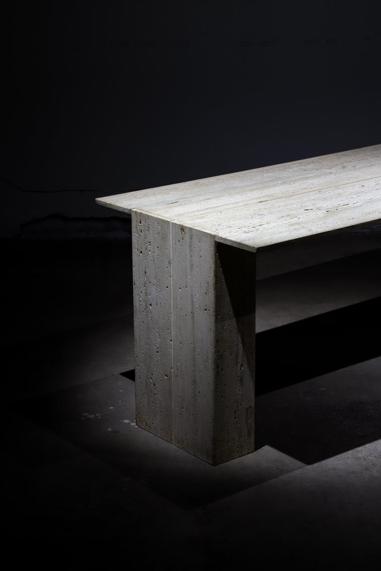 Elegant travertine dining table, entry table or desk. Large travertine slab rests atop two travertine boxed columns.