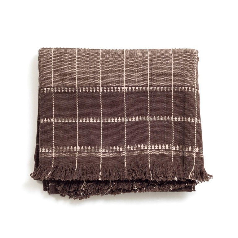Custom design by Studio Variously, Treacle organic cotton throw / blanket is handwoven by master weavers in Nepal.