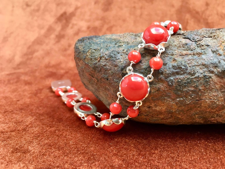 Silver bracelet set with red coral made by hand. These red Mediterranean corals are originated from Torre del Greco Italia. These red corals where stored in safes for more than 40 years. TreasureHuntWorld is specialized in creating new jewelry with