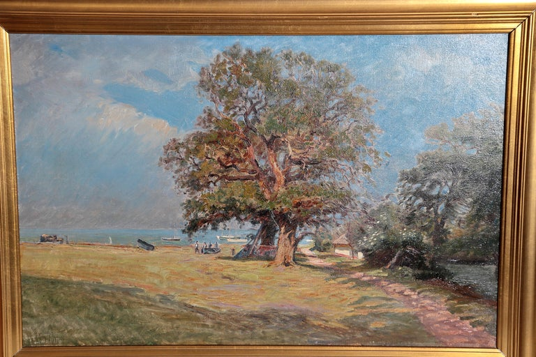 a European landscape painting with blue sky, large leafy tree, and figures near a body of water, by Olaf Viggo Peter Langer (1860-1942) signed and dated lower left, Viggo Langer, Juli 1916 (JULY 1916)  Image only: 18