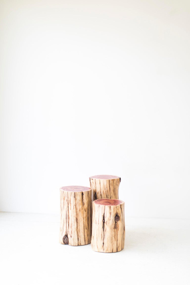 These tree stump tables are made in the heart of Ohio with locally sourced wood. They can be used for a side table, a stool, or grouped together as a coffee table. Each table is handmade with a solid trunk of red cedar with a natural commercial