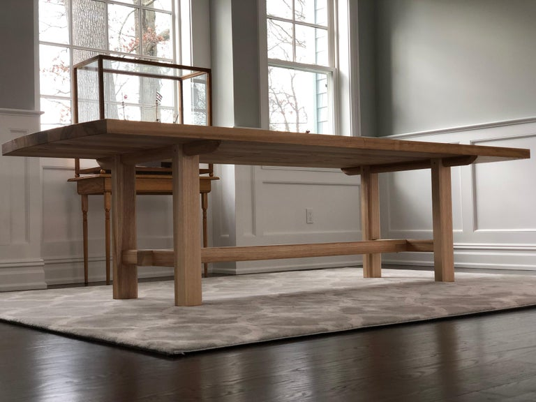 This handmade heavy slab trestle leg dining table features elements unique to traditional Japanese timber framing carpentry work making this a subtle and very sturdy dining table. This table features a heavy slab of quarter sawn white ash, supported