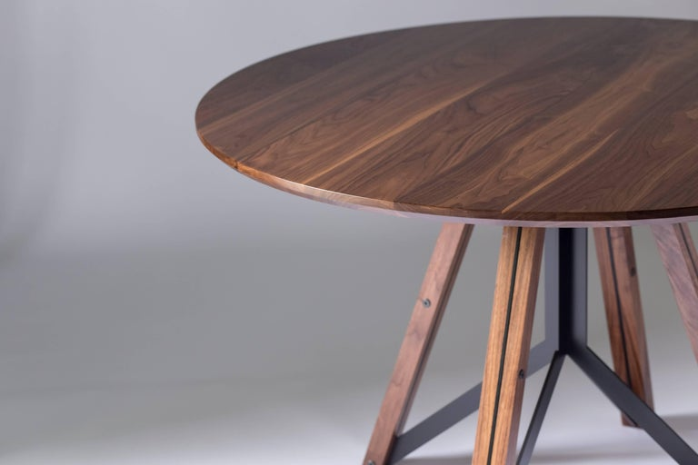 The Trestle - modern walnut, and powder coated steel round dining table