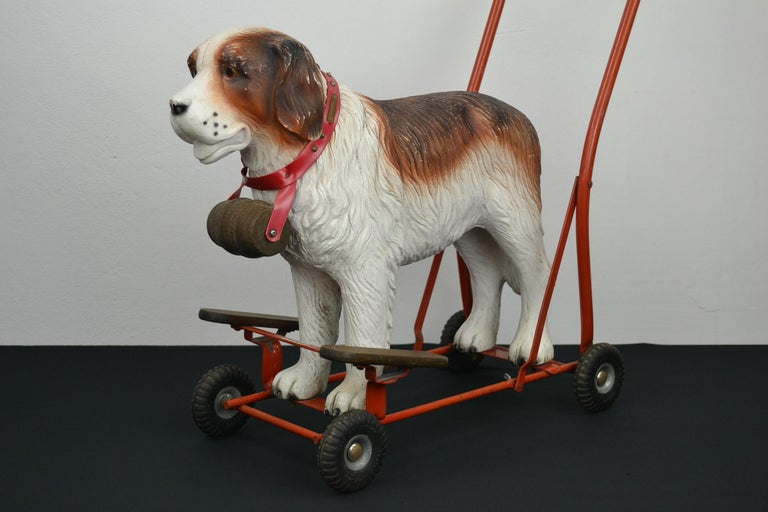 Tri-Ang push along toy with a St Bernard Dog. 