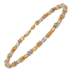 Tri Color 18 Karat White Yellow and Rose Gold Fashion Bracelet
