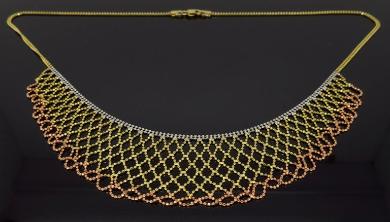 """Unique collar style 14K tri-color gold necklace measuring approximately 17"""" in necklace length with the longest drop length being approximately 1.25"""" and weighing 10.2 grams."""