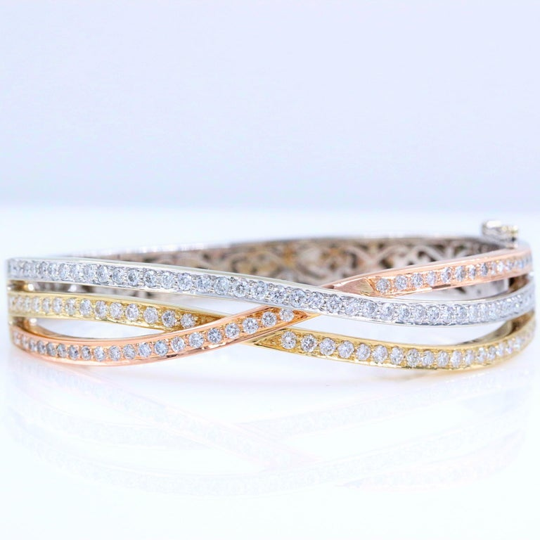 Tri-Color Round Diamonds Bangle Bracelet  Style:  Tri-Color Bangle Bracelet Metal:  14kt White Yellow Rose Gold Size:  Small Width:  10 MM at widest point Measurements:  2.25 X 2 inches - 5.75 inches inside  Total Carat Weight:  2.00 tcw Diamond