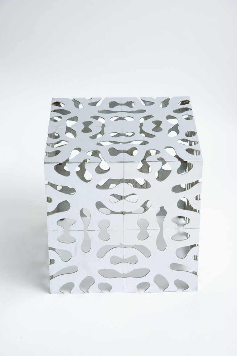 Chrome-plated steel cube table or stool Puzzle table.
