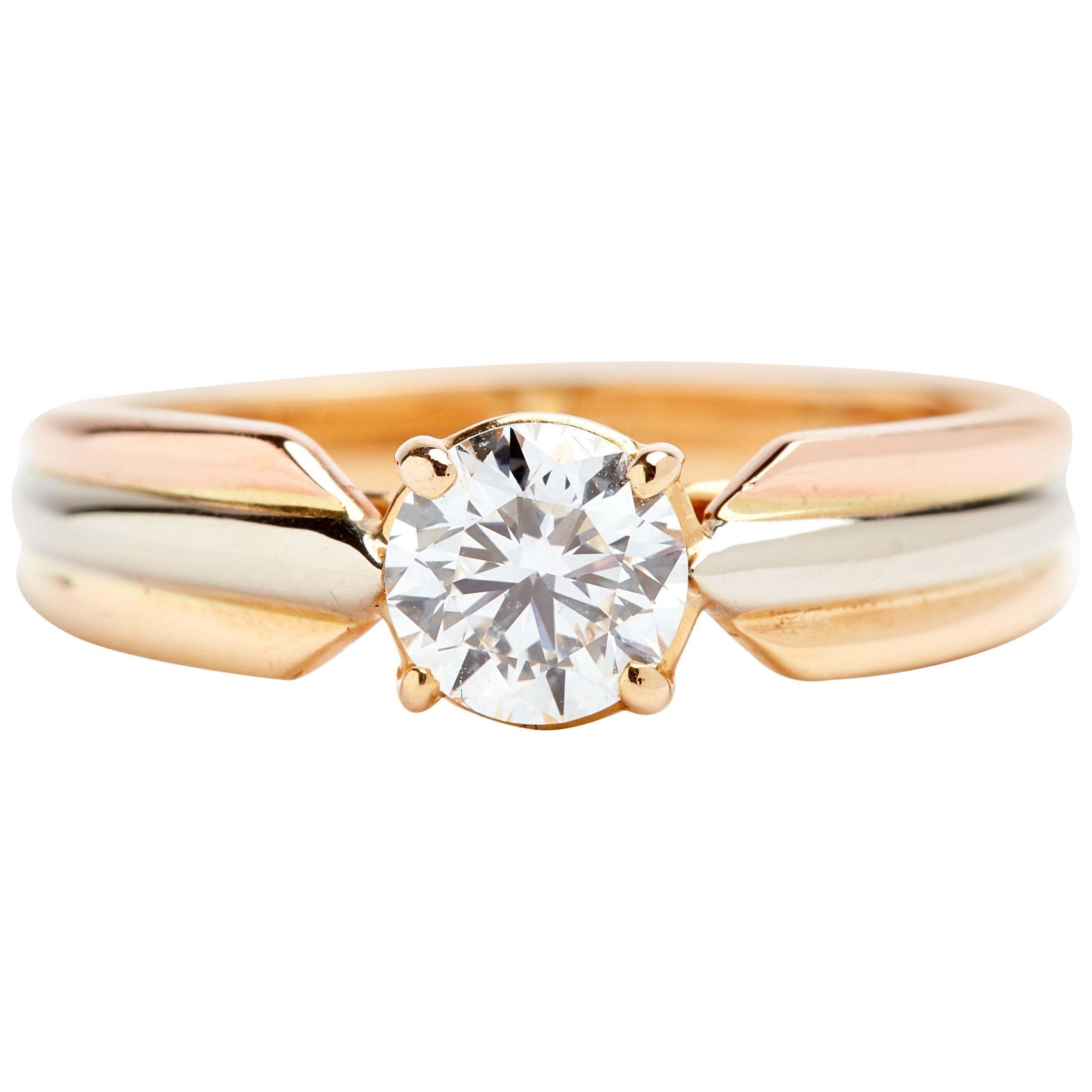 81df560cd6584 Tri-Tone 18 Karat Gold Cartier Solitaire Engagement Ring
