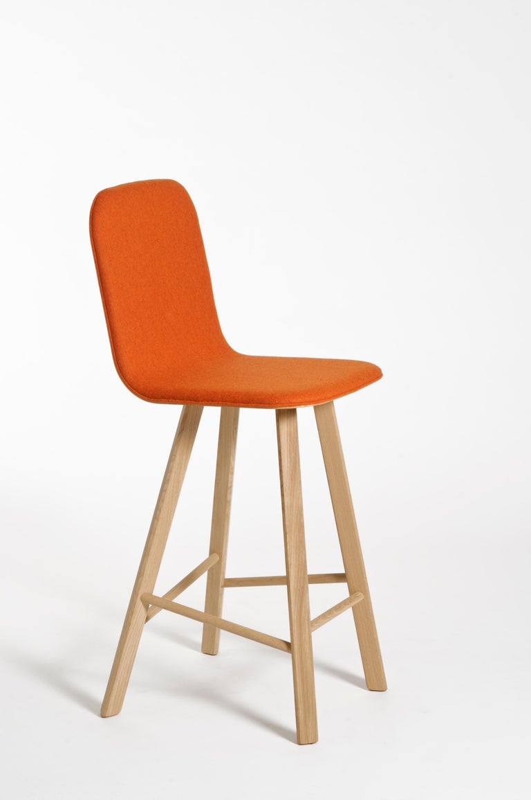 Essential and elegant minimalist stool with a bent plywood shell and four iconic legs with triangular shape in solid oak, joined by transversal wooden bars. The seat can have High Back as listed, for a very comfortable long time seating, or Low Back