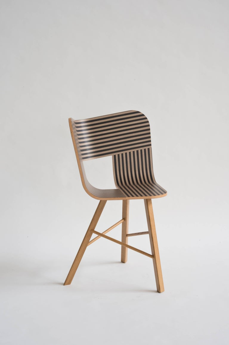 Tria wood chair is the icon of our collection. It's a table chair, but many people use it as a sculpture for the Ambience, in an entrance, a bedroom or in a living room. It recalls the impossible forms of Dutch graphic artist and engraver Maurits