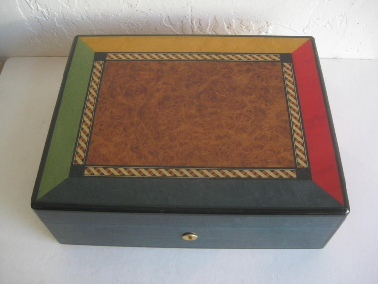 Elegant Triade French cigar tobacco humidor box. Beautiful color inlay with burl wood in the center of the top. Clear lacquer finish. The box is made of solid mahogany. The key is missing. In very nice shape with some minor surface scratches and