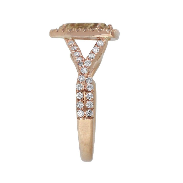 Material: 14k Rose Gold Center Stone Details: Approx. 2.07ctw Triangle shaped diamond. Diamond is J/K in color and SI2 in clarity. There is a visible                                      inclusion that can be seen in the main picture. Diamond