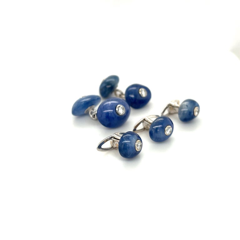 This 18 karat white gold cuff-link /3 stud dress set is designed with polished natural blue sapphire stones. Each sapphire has a bezel set diamond center. The cuff-links are double sided with a chain. Blue Sapphire Cuff Links =28.00 ct  Diamonds
