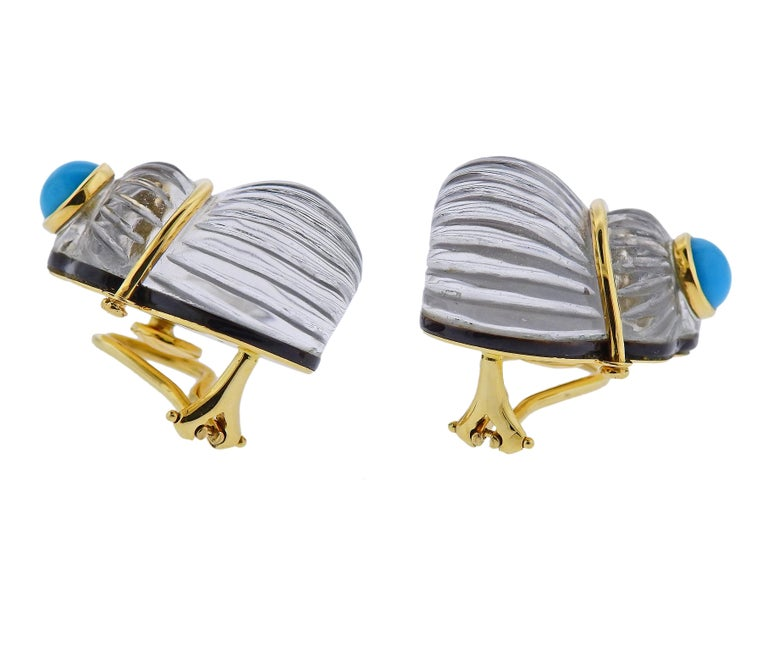18k yellow gold shell motif earrings by Trianon, set with carved crystal, backed with mother of pearl, and turquoise accents.Earrings are 23mm x 21mm, weigh 24.6 grams. Marked: Trianon, 750.