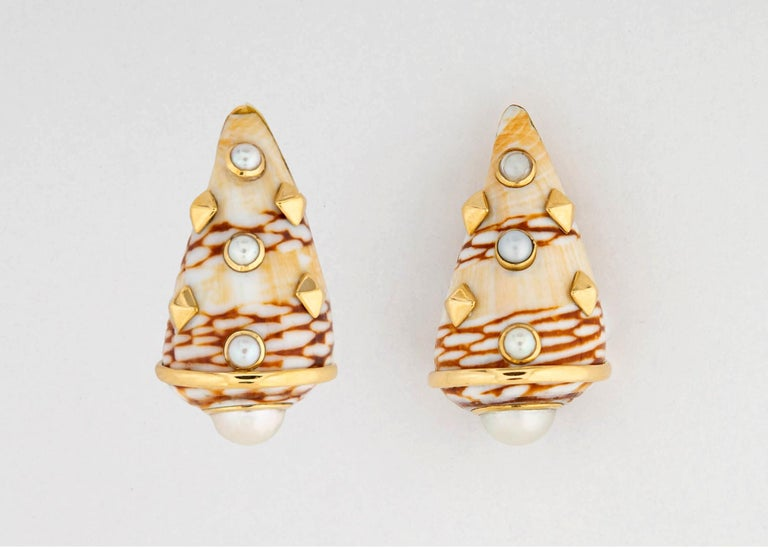 Trianon is famous for there natural shell earrings. This pair features carmel and beige colors accented with beautiful white pearls and 18k gold detailing. Almost 1 1/4 inches in length.