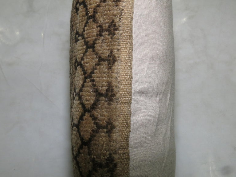 Pillow made from an early 20th century antique Ersari rug with cotton back.