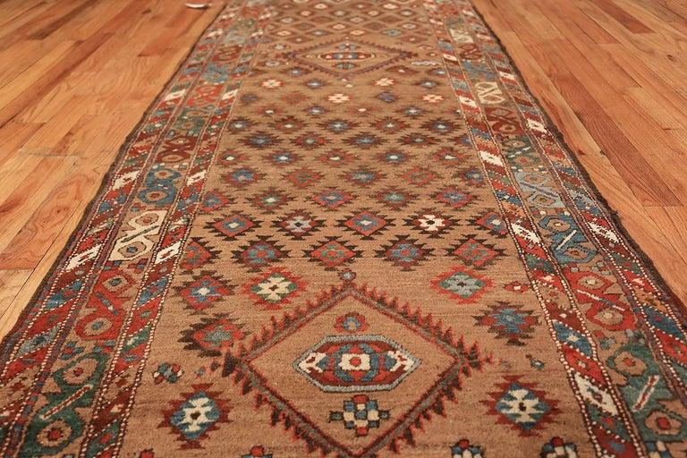 Breathtaking antique Persian Bakshaish runner rug, country of origin / rug type: Persian rug, circa date: 1900. Size: 3 ft 6 in x 10 ft 10 in (1.07 m x 3.3 m).
