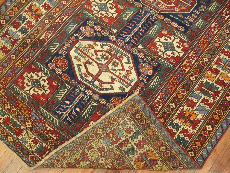 An intermediate size antique Shirvan rug woven in the Caucasian mountainous region.