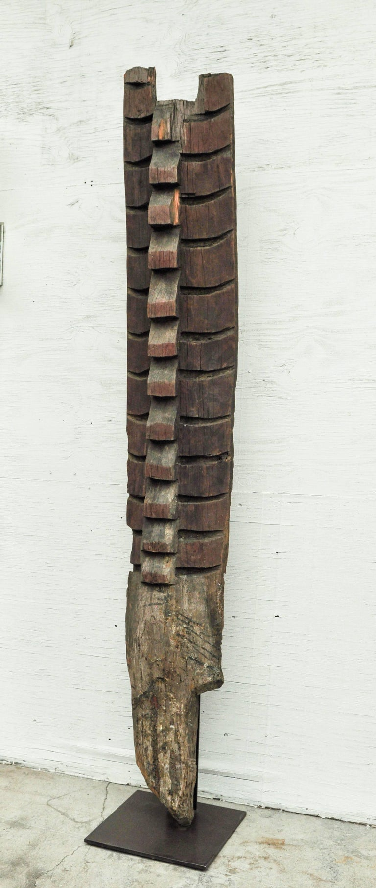 Tribal house panel from Nagaland with mithun motif. Mid-20th century. Mounted on a steel base. This commemorative house panel from Nagaland, most probably from an area bordering Manipur, was a decorative feature marking the house of a respected and