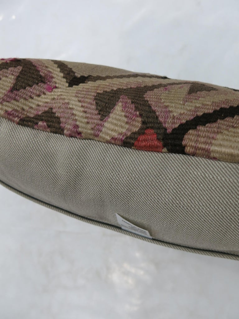 Pillow made from a vintage Turkish Kilim flat-weave.