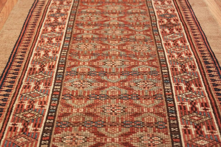 Beautifully tribal long and narrow antique Persian Serab runner rug, country of origin / rug type: Persian rug, circa date: 1900. Size: 2 ft 8 in x 16 ft 5 in (0.81 m x 5 m)  This elegant and tribal antique Persian Serab rug is a masterpiece of