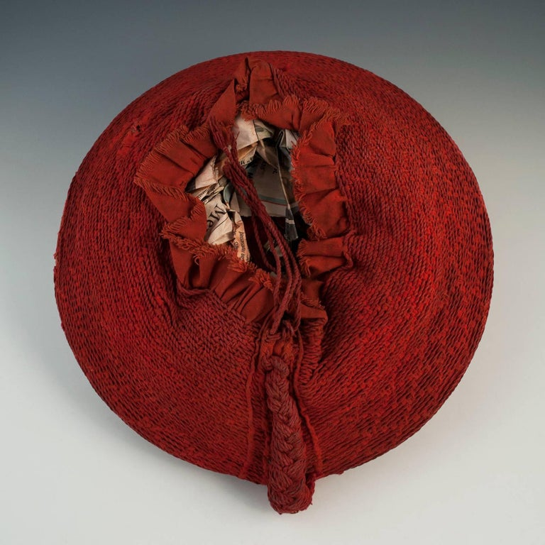Mid-20th century Tribal Zulu women's woven red cotton hat, Isicholo, from South Africa.  The unusual spiral weave on this cotton Isicholo makes this a beautiful and rare example of the hats worn during special ceremonies by married Zulu women. It