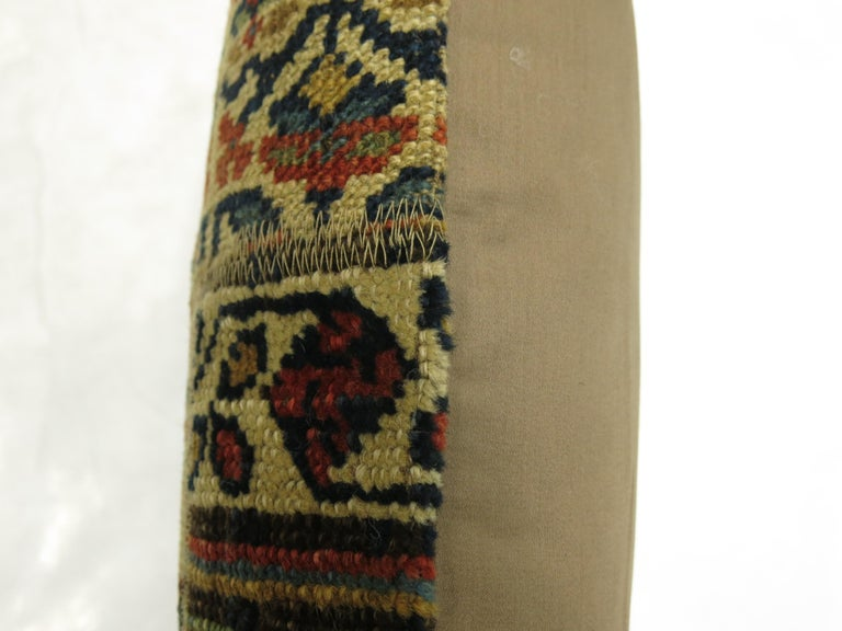 Pillow made from a 19th century Tribal Kurdish rug done in a patchwork format with cotton back and zipper closure included.
