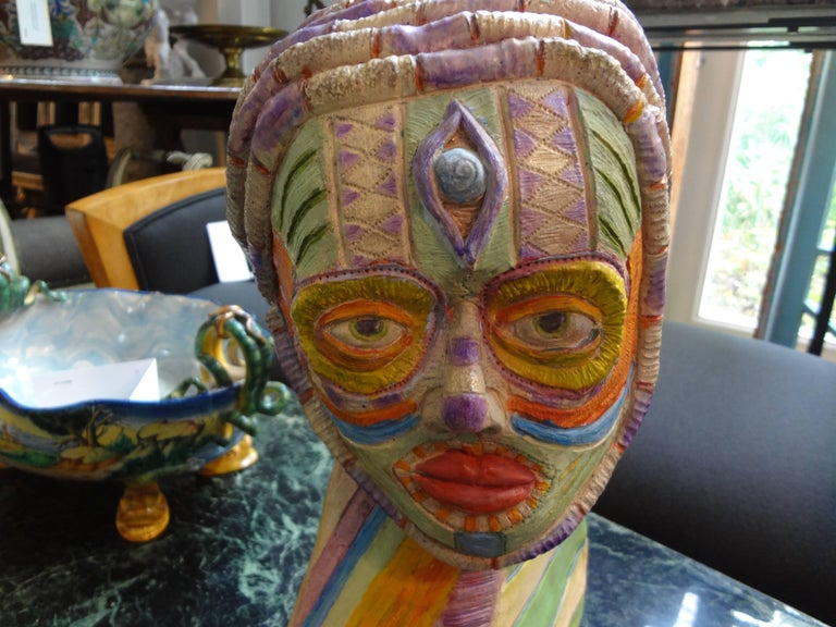 Unusual tribal style/African style artist clay bust from the 20th century. This unique colorful artist sculpture depicts a tribal figure.