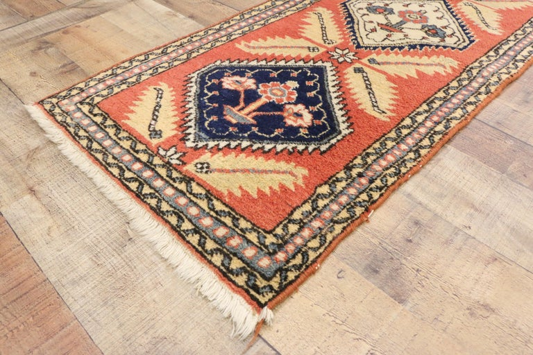 74419 vintage Persian Azerbaijan runner, narrow hallway runner. A stunning Azerbaijan Runner, this beautiful Persian weaving features six alternating diamonds in navy and cream against a bright persimmon backdrop. Each diamond lozenge features