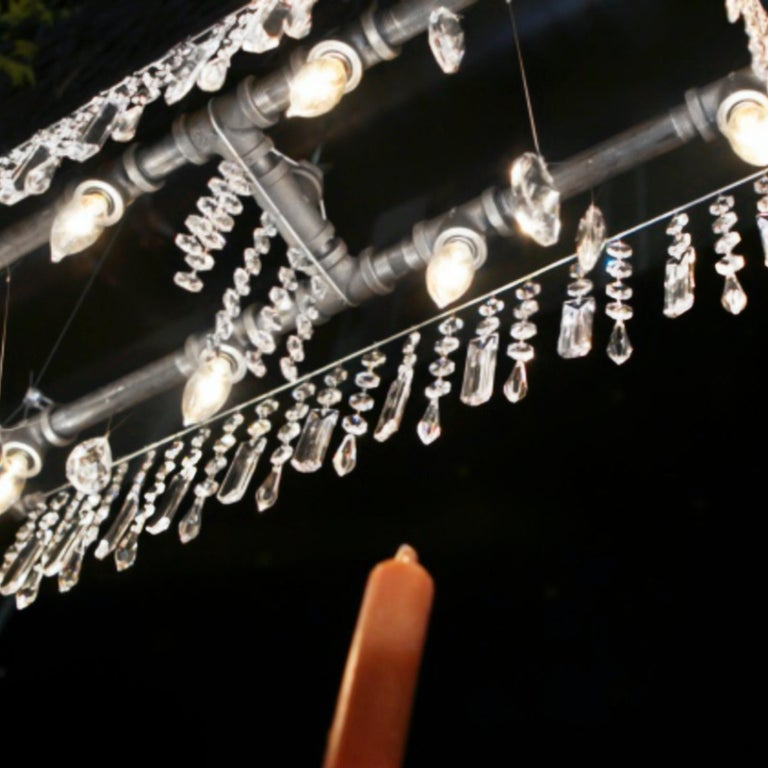 The 8-bulb Tribeca mini-Banqueting chandelier is a smaller version of the Tribeca Banqueting chandelier, and is perfectly suited for applications where a shorter linear fixture is called for: hallways, smaller dining room tables, kitchen islands, or