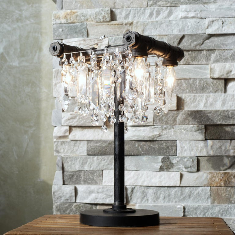 Brand new for 2021. Bring a bit of our industrial-glam bling to your table or desktop with the Tribeca chandelier table lamp. Beautiful, high-quality, gem-cut crystals are contrasted with a simple structure of rough-hewn black steel pipes and