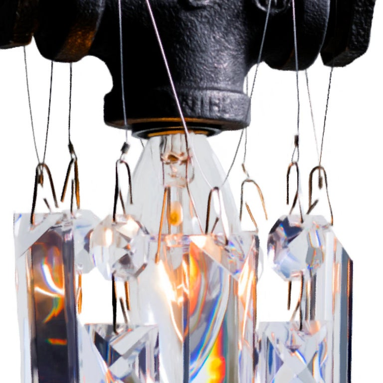 This single-bulb Tribeca chandelier pendant is a small jewel of an industrial-chic crystal pendant. Made from rough, masculine black steel gas fittings and high-quality gem-cut crystal, this little sparkler exudes urban sophistication and contrast.