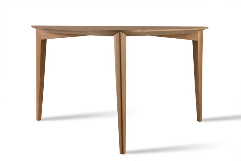 Trident, contemporary table made of ash wood or canaletto walnut with triangular top and three legs of triangular section.