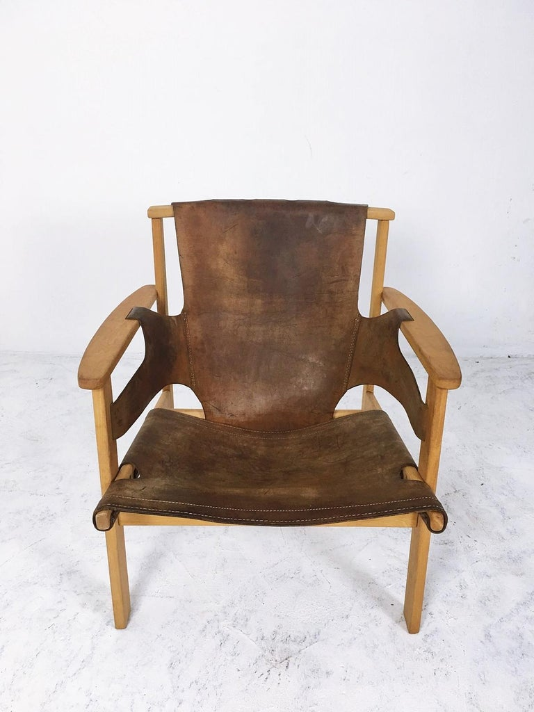 """""""Trienna"""" lounge chair by Carl-Axel Acking, made from oak and leather. This model was designed in 1957 and presented at the Milano Triennial that year, as part of the Swedish exhibit.  Manufactured in Hungary  Some Imperfections Minor losses."""