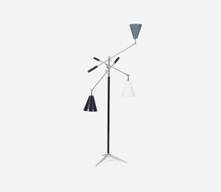Triennale floor lamp by Angelo Lelli for Arredoluce. Tri-color shades, original leather counter weight wraps, brass arms, chrome tripod base. Marked
