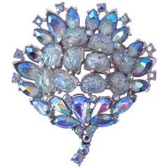 Trifari Blue Brooch with Aurora Borealis Rhinestones and Lava Glass Stones