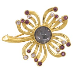 Trifari Gold Flower Pin Brooch with Amethyst Crystals and Cabochon