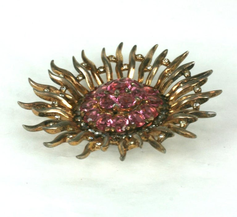 Trifari Sterling Vermeil Sunburst Clip by Alfred Phillipe. Pink gold wash over sterling with a some of oval cut pink pastes with pave accents.  High Quality Trifari manufacture. Clip fitting for stabilization on garment.  1940's USA.  2.5